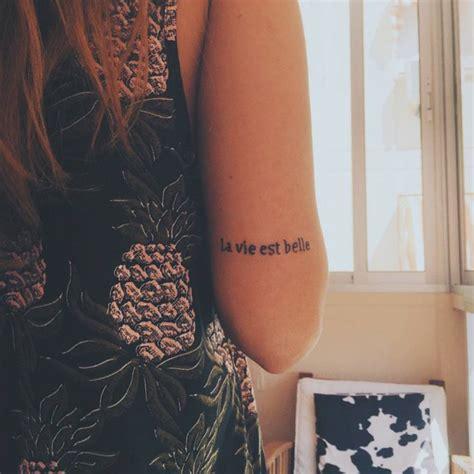 tattoo lifetime care little tricep tattoo saying quot la vie est belle quot french