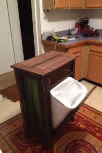 white rolling kitchen island with tilt trashcan and