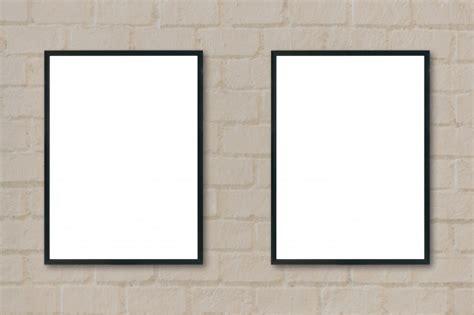 cornici nere cornici nere pendono da un muro scaricare foto gratis