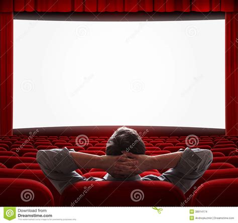 one alone in empty cinema stock photo image