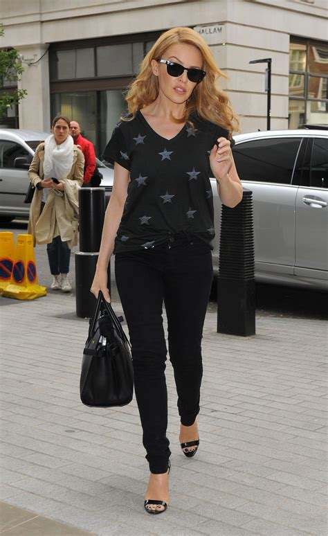 casual chignon updo hairstyle for women kylie minogue hairstyle kylie minogue casual style bbc studios in london may 2014