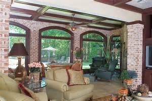 Basement enclosed patio featuring herringbone brick and large windows