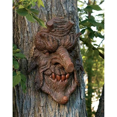tree face bewitched oak tree face statue greenman ent trunk bark