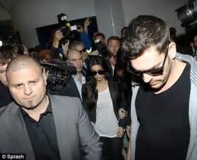 kim kardashian slams marriage hoax as she jets into