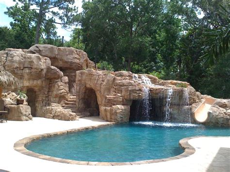 hidden backyard pool great waterfall into pool with hidden grotto and a slide central florida custom pools
