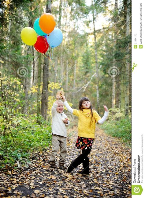 boy  girl  balloons   forest stock photo