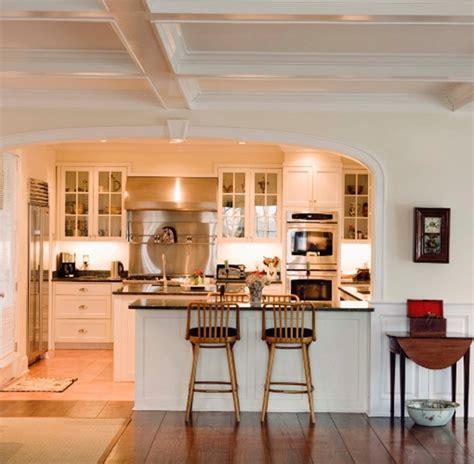 breakfast bar between kitchen and living room cozinha americana