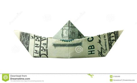 Dollar Bill Origami Boat - origami boat folded from 100 banknote royalty free stock
