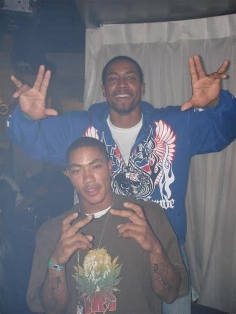 bitches  blue chicago bulls derrick rose flashing gang sign