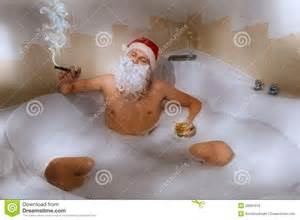 santa with whisky and cigar sitting in bath tub stock