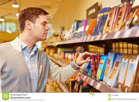 Where To Buy A Bar Buying Chocolate In Supermarket Stock Photo Image