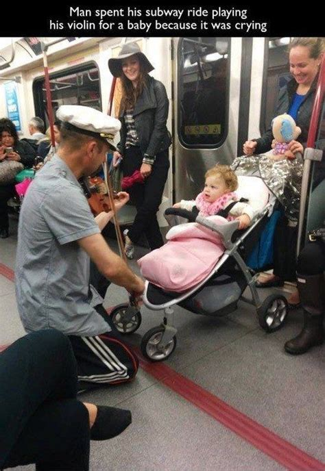 how to comfort a crying man man spent entire subway ride playing the violin to comfort
