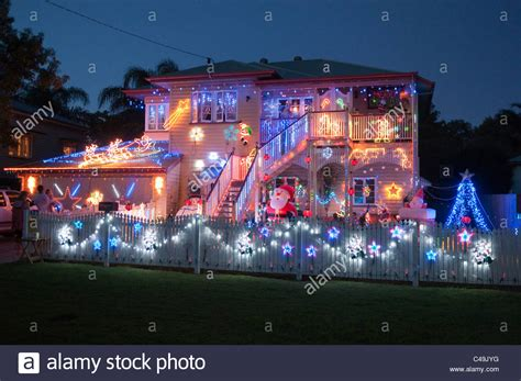 we buy houses brisbane christmas lights decorating a house brisbane queensland australia stock photo