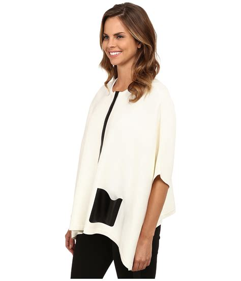 Sweater Ck T1310 3 calvin klein sweater cape with faux leather pocket in white lyst