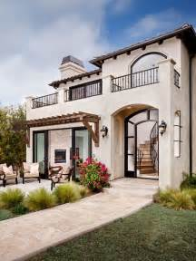 Mediterranean Home inspiration for an expansive mediterranean beige split level stucco