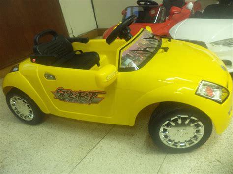 jual mobil anak sport warna kuning keren ada bagasi belakang bisa di buka mobil anak