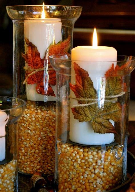 candelabros para velas candelabros con velas y hojas secas decorativas