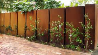 Garden ideas together with brick house with white picket fence