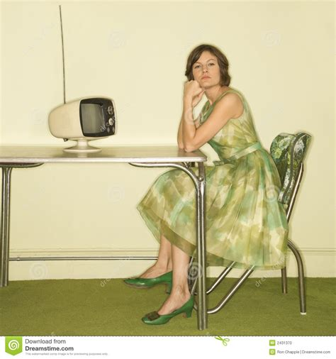 Extended Dining Table woman sitting at table stock photo image of bored