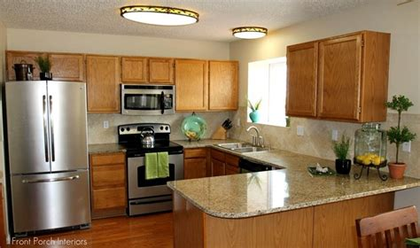 photos of kitchens with new venetian gold granite new venetian gold granite with oak cabinets