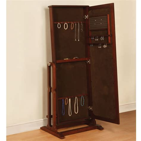 free standing jewelry armoire with mirror the free standing mirrored jewelry armoire hammacher