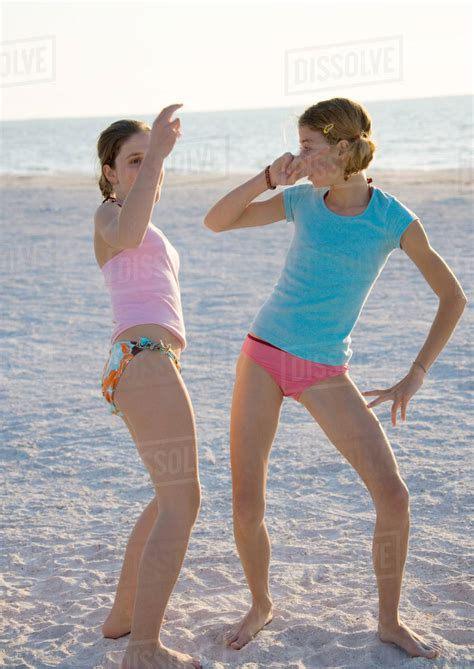 preteen girls pic s two preteen girls dancing on beach stock photo dissolve