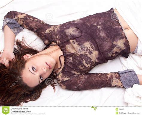 girls laying in bed girl laying in bed royalty free stock photography image