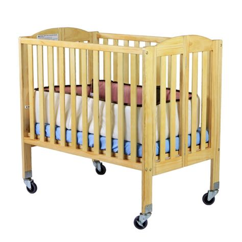 Portable Crib Dimensions by 2 In 1 Folding Birch Portable Crib On Me