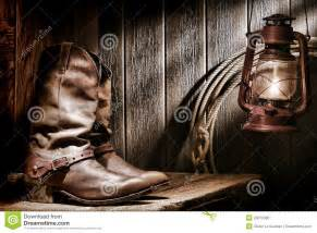 American Flag On Barn Wood American West Rodeo Cowboy Boots In Old Ranch Barn Stock