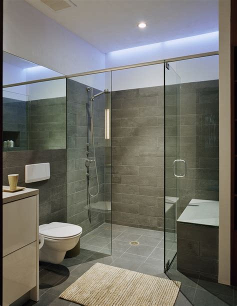 the bathroom with a glass wall with a view to the bedroom the nove 1 residences by studio b architects in aspen