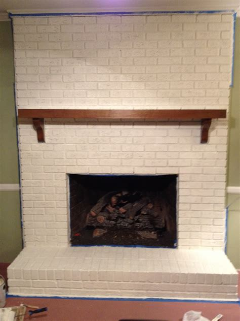 wonderful white color brick wall panels painted fireplace added wooden wall shelf as decorate in