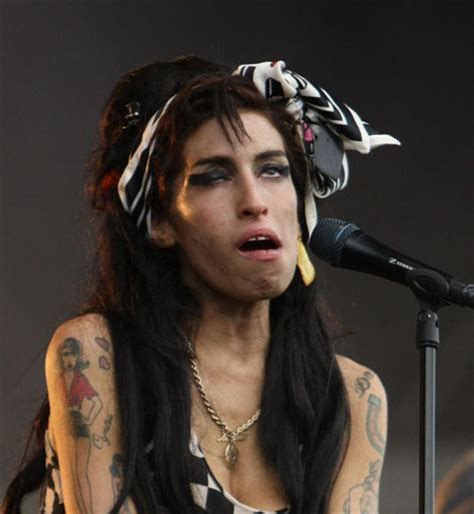 amy winehouse on stage, not looking her best | kate gale