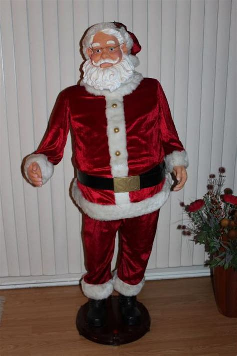 gemmy life size animated singing dancing karaoke santa