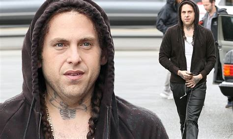 jonah hill tattoo jonah hill unrecognizable with braided hair and tattoos