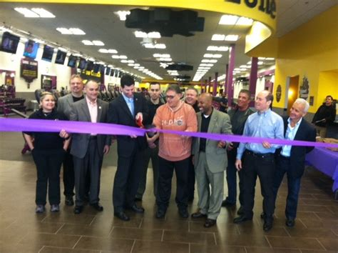 planet fitness cuts the ribbon at grand opening news