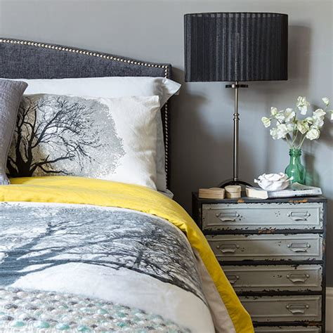 grey bedroom with industrial style bedside table