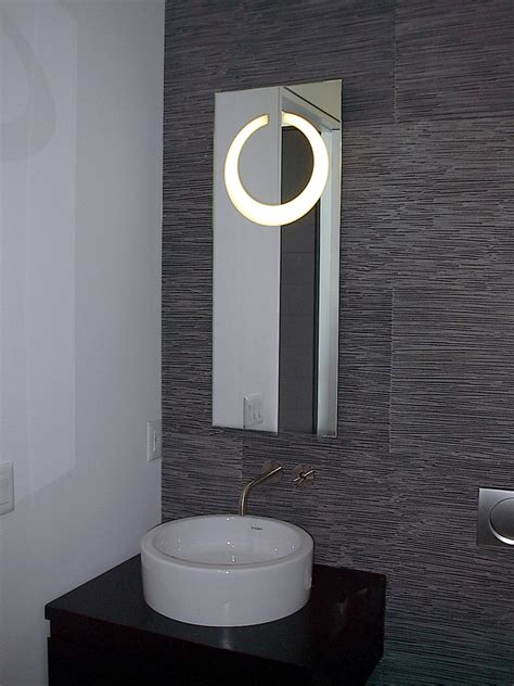 bathroom mirror with lights behind cabnet glass