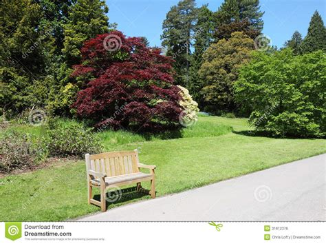 english park bench summer in an english park with bench seat royalty free stock image image 31612376