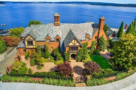 classic seattle lakefront house gets a bookish modern twist a waterfront tudor home brings a classic style to modern