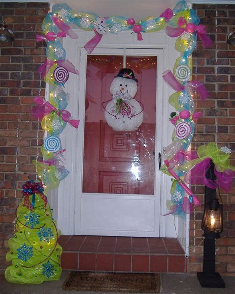 christmas door love the garland door candyland