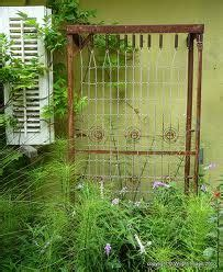rusted bed spring trellis omg