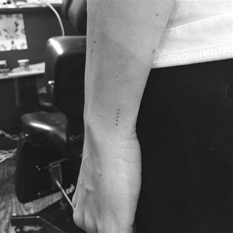 straight line tattoos meaning five dots in a line on the left wrist