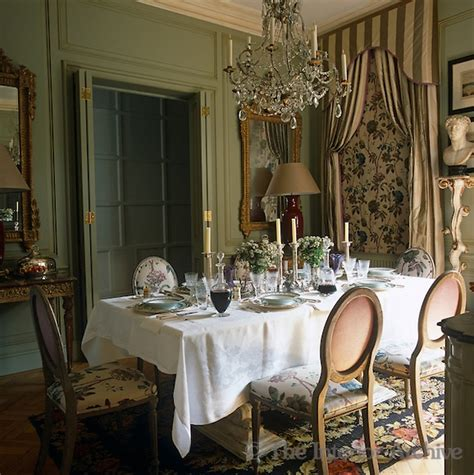 paolo moschino flemish style chairs surround an italian table laid with