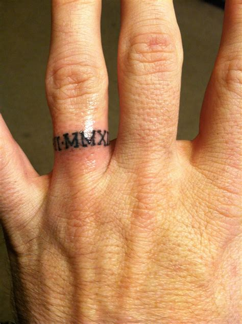 roman numeral ring tattoo anniversary in numerals ink ed