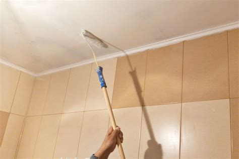 how do you paint a ceiling the easiest way to paint a