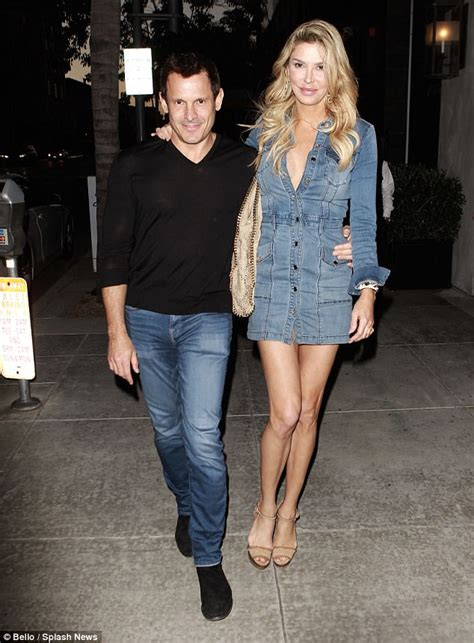 brandi glanville boyfriend jeans brandi glanville flashes assets in mini dress out with dj