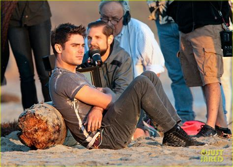 zac efron we are your friends zac efron hangs out shirtless on the beach with we are