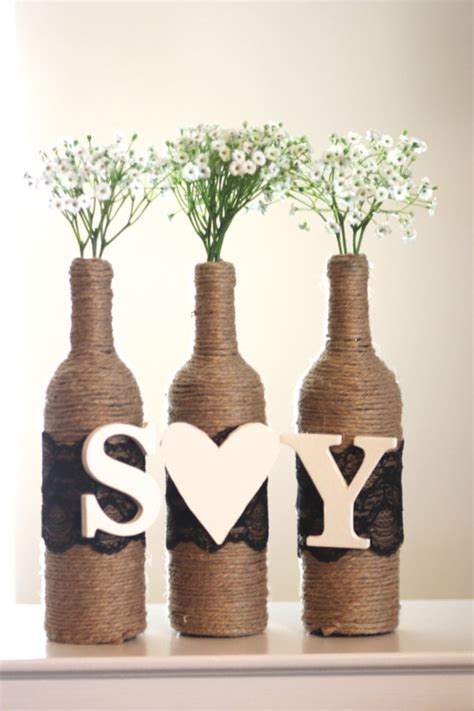 rustic centerpiece wrapped wine bottles with two letters and