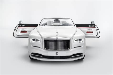 roll royce orange rolls royce presents dawn convertible with red blue and