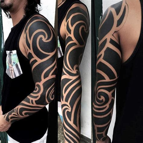 negative space tribal tattoos 75 tribal arm tattoos for interwoven line design ideas
